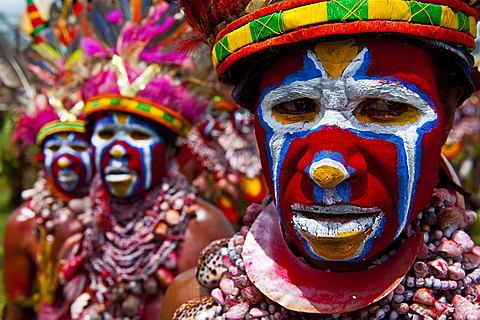 Colourfully dressed and face painted local tribes celebrating the traditional Sing Sing in the Highlands, Papua New Guinea, Pacific